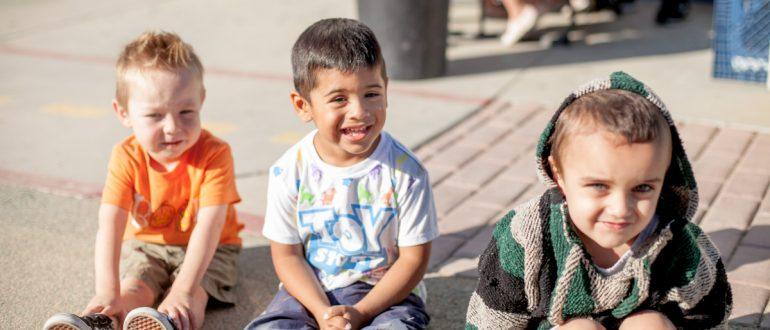 Little iLEADers children smile at camera